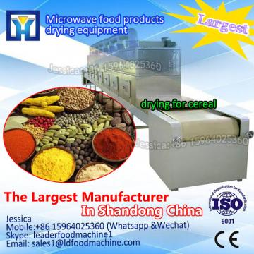 Microwave tunnel dryer for vegetable dehydration